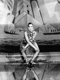 Josephine Baker dancing the charleston at the Folies Bergère in Paris for La Revue nègre in 1926. Notice the art deco background. (Photo by Walery)