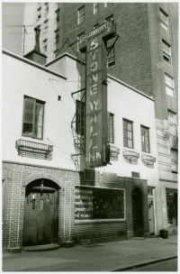 "The Stonewall Inn, taken September 1969. The sign in the window reads: ""We homosexuals plead with our people to please help maintain peaceful and quiet conduct on the streets of the Village—Mattachine""."