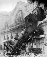 The train implies the train wreck, photo: Train wreck at Montparnasse (October 22, 1895) by Studio Lévy and Sons